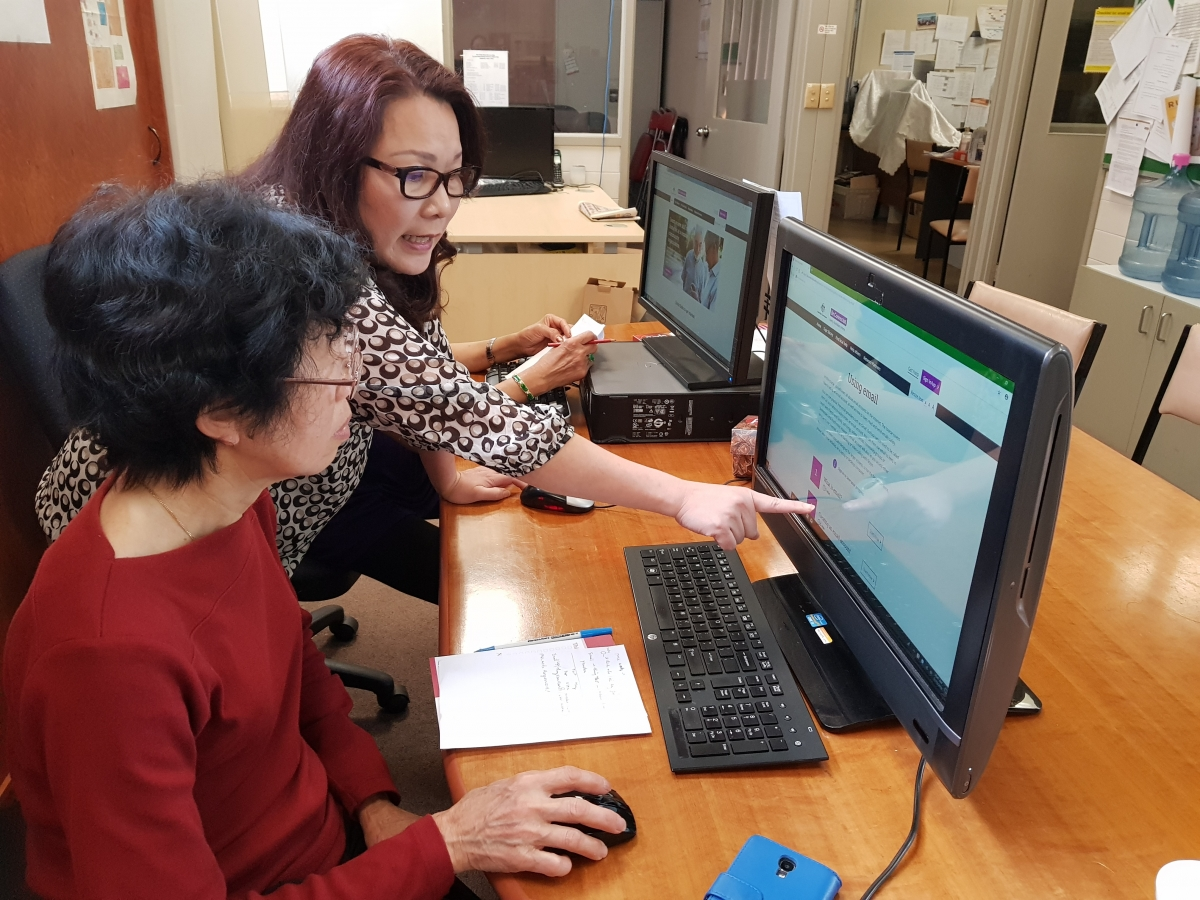 Ly teaches someone on the Be Connected Learning Portal.