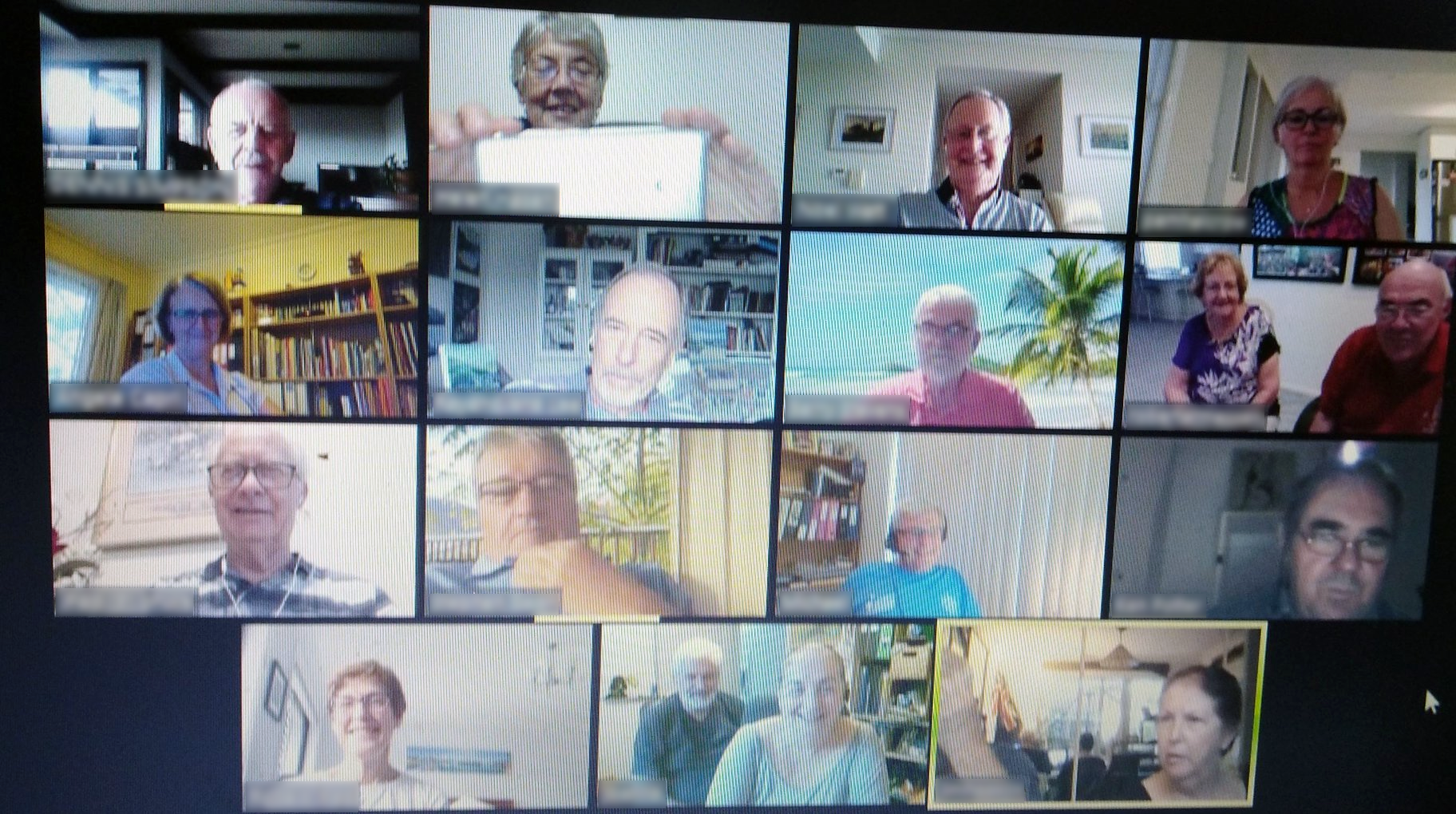 Screenshot of a Zoom session where Helen is teaching 14 others on how to use video conferencing.